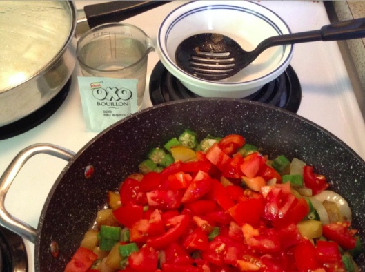 adding diced tomatoes to okra stew