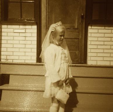 Little Blonde Girl's First Communion