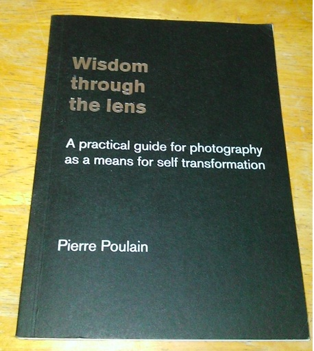 Book cover Wisdom through the lens - A practical guide for photography as a means for self transformation