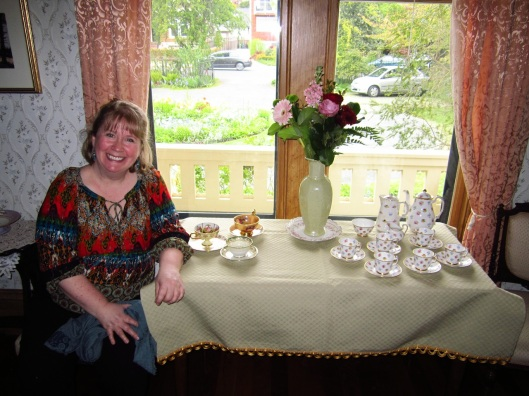 Blonde Lady sitting at tea table in Emily Carr house