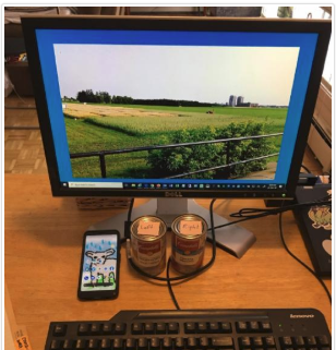 PC screen with soup cans and cell phone